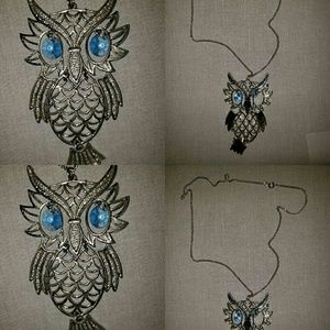 Sterling silver blue eyed owl pendant